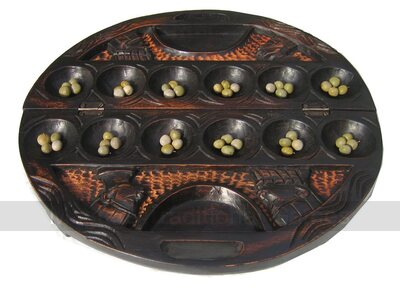 Ornate Mancala Carved Circular Oware game (Mahogany stained with bonduc seeds)
