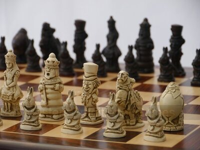 Alice in Wonderland Ornamental Chess Set (cream & brown, board not included)