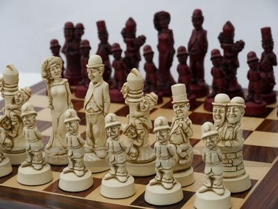 Berkeley Movie Stars Ornamental Chess Set (cream & red, board not included)