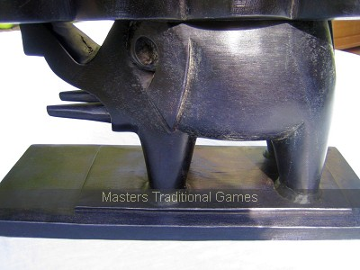 Low Mancala Oware Table with carved Elephant stand (with bonduc seeds)