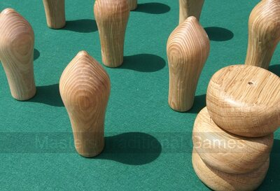 Set of Northamptonshire skittles pins and cheeses (polished Oak)