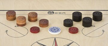 Set of Carrom pieces with striker